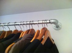 Galvanize plumbing pipe turned closet rod use to hang curtain to cover murphy bed
