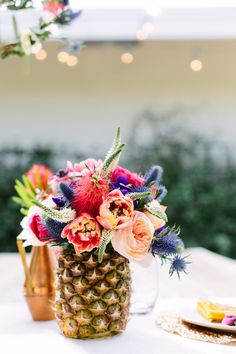 Why spend a fortune on a vase when a hollowed-out pineapple looks this good? #DIY