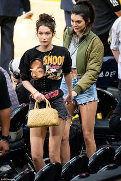 Leading the way: Bella moved ahead of Kendall, leading her pal by the hand