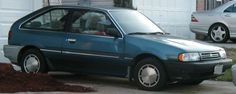 Mercury Tracer hatchback...5 speed with a Mazda engine.  A very peppy car!  Mine was dark red.