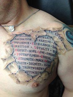 torn skin chest tattoo