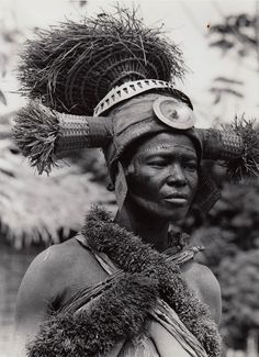 """Dancer from the Ekona people. Isangi, Bikoro, Belgian Congo (today, the Democratic Republic of Congo) 
