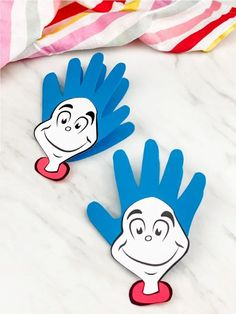 Looking for a fun and easy Dr Seuss craft for preschoolers? This handprint thing 1 printable craft is perfect for kids! It comes with a free printable template and is simple to make at home or at school! Download today. #simpleeverydaymom #kidscrafts #drseusscrafts #preschoolers #preschool #preschoolcrafts #craftsforkids #thing1crafts #handprintcrafts #ece
