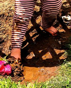 To Be a Kid Again, fine art photography prints by Margaret Newcomb. A child's legs and feet playing with the mud between her toes. No toys necessary, just like in the good old days. #canvaseprints #cards #posters #fineartamerica #child #mud #prints