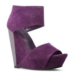 Purple peep toe wedge.