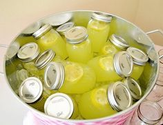 Such a great idea! Lemonade served in mason jars! Love how they are displayed in a bucket. Great for any party or baby shower.--- might have to try this with sweet tea at the wedding Southern Baby Showers, Limonade Rose, Mason Jar Drinks, Mason Jar Lemonade, Festa Party, Partys, Sweet Tea, Yummy Drinks, Party Planning