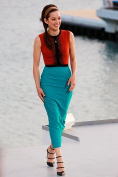 Marion Cotillard in a teal and orange beaded ensemble and strappy black Gianvito Rossi.