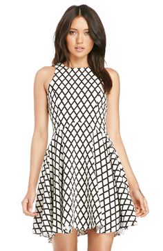 Sleeveless fit and flare dress featuring a diamond grid print, princess seams, full lining and an invisible back zipper with hook and eye closure. By Lucy Paris.