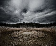 Haunted Earth: 14 Eerie Landscape Photos  bySteph    The earth is a beautiful place, filled with too many awe-inspiring views of nature to count. But there's also a dark side. That same river that sparkles in the sunlight turns ominous in the night. Ferocious oncoming storms fill us with a sense of dread. The pitch blackness of the forest warns us of the dangers that lurk within. These 15 incredibly creepy landscape photos capture that darkness to spine-tingling effect.  Edge of the Woods…