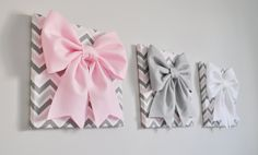 Large Gray, Light Pink, and White Bows on Gray and Pink Chevron Canvases 12 x12 Wall Hanging. Wall Decor ***Matching and Coordinating Pillows Available Please see Shop: http://www.etsy.com/shop/bedbuggs  ALL ITEMS ARE MADE TO ORDER PLEASE SEE SHOP FOR CURRENT CREATION TIME!!!  Stunning Touch to any wall and room! More Flower Designs and Colors Available, we can custom to your decor!  Bows are made from the Highest Quality Wool Felt. Bow measures about 10 wide and 10 Tall a...