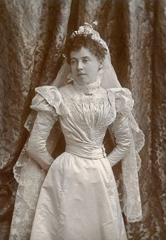 Young lady poses in her wedding dress, 1885