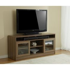 Making room for up to a 65-inch flat panel TV is just the start. This stand features two storage compartments for all your electronic equipment, with both ventilation and wire management solutions. The center shelf is made to hold a sound bar.