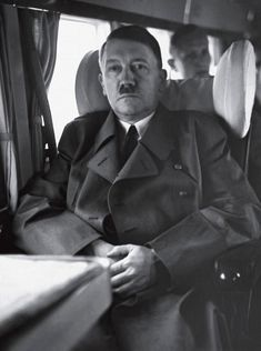 A real color photo of Adolf Hitler in 1943 on his airplane. This photo was taken by Walter Frentz. a B/W version is below.