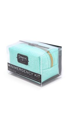 This Minimergency Kit is packed with fashion fix essentials for the woman on the go. Includes double-sided tape, a safety pin, a mending kit, earring backs, dental floss, clear nail polish, an emery board, nail polish remover, stain remover, hair spray, hair elastics, a tampon, pain reliever, breath freshener, and lip balm. Packaged in a tiny, snake-embossed zip pouch. http://rstyle.me/n/mvvcvnyg6