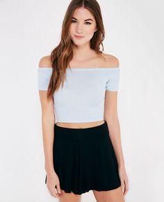 <p>This basic crop tee features a soft ribbed knit fabric, a flirty off-the-shoulder design, and a stretchy snug fit.</p>  <p>Model wears a size small.</p>  <ul> <li>Off-the-Shoulder</li> <li>Short Sleeves</li> <li>Unlined</li> <li>Rayon / Polyester / Spandex</li> <li>Hand Wash</li> <li>USA</li> </ul>