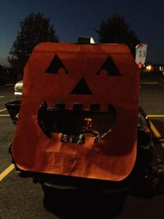 Trunk or Treat deco. White poster board painted as pumpkin.