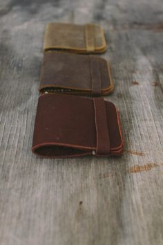This is a very simple, very thin leather wallet. It has a semi curved pocket for easy access to your cash and a slot for cards. The top flap folds over the front of the wallet for a secure close.