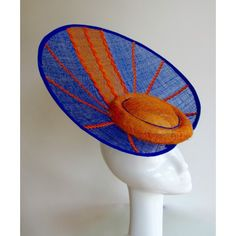 #aintreegrandnatonal #kentuckyderby #epsomderby #royalascot #galwayraces #gloriousgoodwood #prixdelarcdetriomphe #melbournecup #aintreegrandnatonalhats #kentuckyderbyhats #epsomderbyhats #royalascothats #galwayraceshats #gloriousgoodwoodhats #prixdelarcdetriomphehats #melbournecuphats A truly stunning headpiece that would turn heads at any occasion. The main colour is Royal Blue with Tangerine Orange accents.