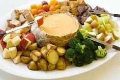 Gruyere Fondue (with apples & pears, potatoes & blanched broccoli, steak, and crusty bread).