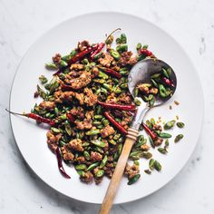 Sichuan-Style Green Beans with Pork | Food & Wine  Sub Coconut Aminos and Red Boat fish sauce for soy sauce to make it Whole 30 Compliant.