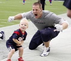 Houston Texans defensive end J.J. Watt photo bombs Calhoun McNair, 2, who is the son of Cal McNair on the field before the start of an NFL football game at NRG Stadium, Sunday, Sept. 28, 2014, in Houston. ( Karen Warren / Houston Chronicle  )