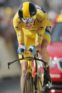 Christopher Froome of Britain, wearing the overall leader's yellow jersey, strains in the last meters of the eleventh stage of the Tour de France cycling race, an individual time trial over Chris Froome, Kingdom Of Great Britain, Mont Saint Michel, Road Racing, Cycling, Bicycle, Tours, Stage, July 10