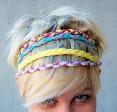 upcycled t-shirts into headbands, adjustable with a wooden bead at the back.
