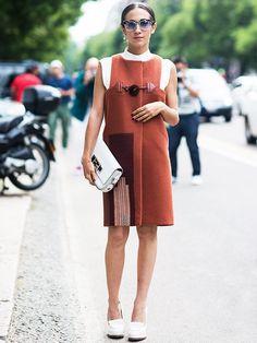 Delfina Delettrez Fendi in a burnt orange dress, white loafer platforms, white clutch, and sunglasses