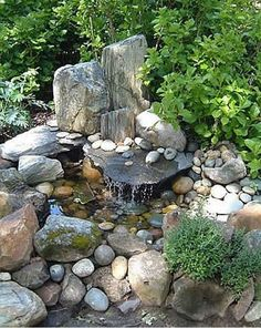 Build up the waterfall rocks and add large lush thick bushes such as hydrangeas