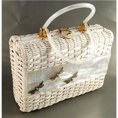 1960's wicker handbag. My grandma had one just like it. Always smelled like her powder compact and Certs..