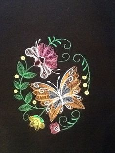 embroidered tropical quilt blocks on black kona cotton quilt