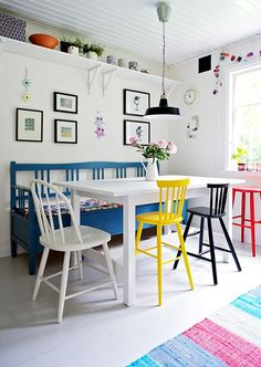 whimsical colorful dining room table bench painted chairs white walls