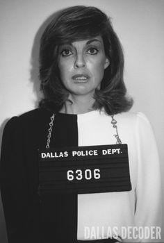 "Sue Ellen (Linda Gray), after being arrested for J.R.'s shooting, has her mug shot taken in this 1980 publicity shot from ""Who Done It?"" a fourth-season ""Dallas"" episode. Relive more memories at DallasDecoder.com."