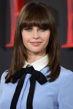 The 10 most popular haircuts for spring 2017: Felicity Jone's layered hair and fringe bangs is a great cut for anyone with thick hair