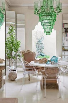 Antique style & lucite chairs, light filled dining room