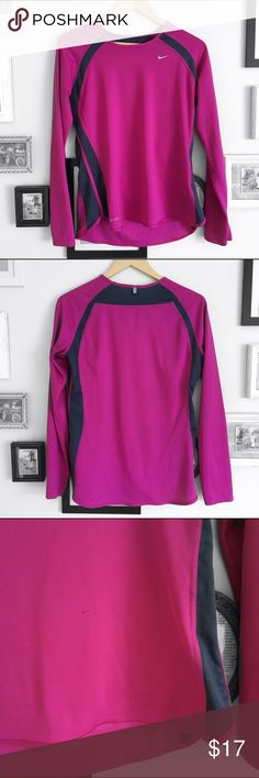 Nike Long Sleeved Shirt Purple Nike Dri-Fit Shirt with navy blue stripes down the side. There is a snag which is pictured in the 3rd photo.   ⭐️10% off 2+ bundle ⭐️Size Large ⭐️Smoke Free Home  ⭐️No stains Nike Tops Tees - Long Sleeve