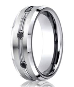 An affordable yet luxurious diamond and cobalt chrome wedding band for men. This contemporary men's wedding ring from Benchmark infuses an architectural design with memorable black diamonds.