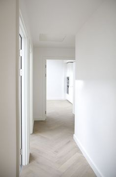 whitewashed herringbone wood floros in hallway decor with white walls, White Linen Walls & Pale Lime Wash Fishbone Flooring Living Room Interior, Interior Design Living Room, Design Bedroom, Kitchen Interior, Planchers En Chevrons, Floor Design, House Design, Interior Design And Construction, Herringbone Wood Floor