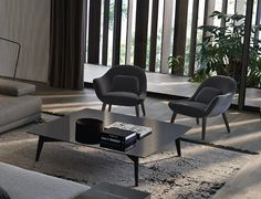 Poliform_Mad Chair armchairs with fabric covered body and legs in solid wood in spessart oak finishing. A product that interprets the possible variants of tub chairs in an original way, through primary shapes.