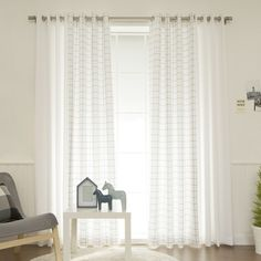 Features:  -Set includes 2 solid curtain panels and 2 sheer curtain panels.  -Doshie collection.  -8 Stainless steel nickel grommets per panel.  Product Type: -Panel pair.  Pattern: -Plaid & Check.  C