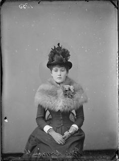 Early 1880's.love the fur capelet and flowerpot styled hat.