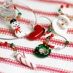 Mini Christmas Wine Charms. Could anything be more charming than these mini Christmas wine charms? They're perfect for holiday parties and winter weddings alike.. Price: $13.90