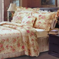 Romantic Chic Shabby Cottage Roses 100 percent Cotton Quilt and Shams Set . The bedding set features scalloped edges and is reversible to a petite roses pattern. Made of 100% cotton cover and fill.