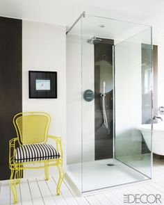 The+Most+Comfortable+Baths+Have+One+Thing+In+Common  - ELLEDecor.com bathroom casa midy yellow chair #colorfurniture