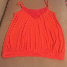 Cute orange shirt Orange Express tank top. Embroidered orange flowers on top front. NWOT. Never worn. Size large Express Tops Blouses