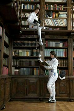 Épée in a library Women's Fencing, Fencing Sport, Fencing Foil, The Fencer, Letting Your Guard Down, Sword Fight, Kendo, Sport Photography, Mascaras