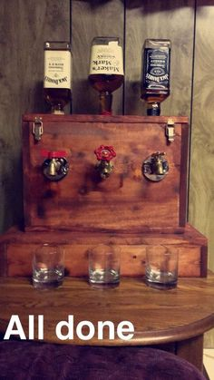 Over 40 different options for décor to create your perfect man cave.We believe some of these man cave ideas will inspire you to build an enjoyable space. Whiskey Dispenser, Drink Dispenser, Alcohol Dispenser, Water Dispenser, Whisky Spender, Garage Bar, Garage Ideas, Basement Ideas, Man Cave Bar
