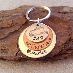 This is the Perfect Keychain for your Dad who works hard as a Truck Driver, to keep his love for you and close to him at all times! DAD is hand Stamped into the top pendant along with a Truck. My Supe
