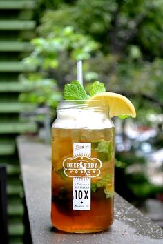 """The Kelsey: Mint-infused Deep Eddy Sweet Tea Vodka with a hint of peach flavor and garnished with a lemon"""