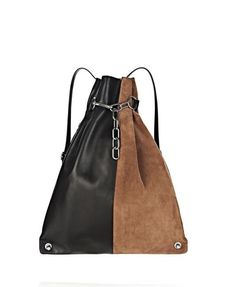 Alexander Wang . my only one. Genuine suede and leather body. Chain with hook that allows you to adjust where on the link you want it for the look. Two side zippers: One goes into the main compartment (the main way to access the bag), the other goes into a separate pocket that is the size of half of the bag.